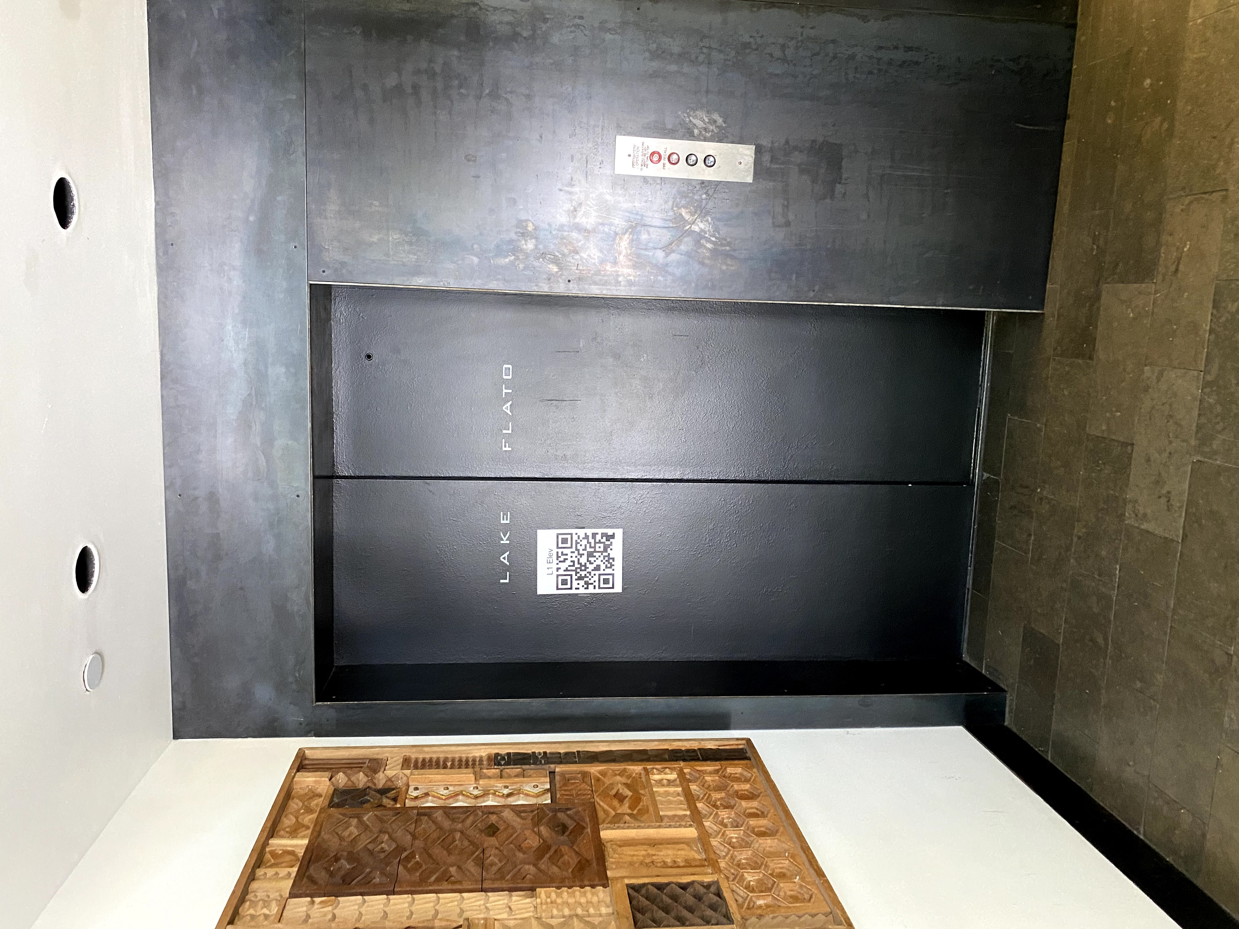 QR code used to align hologram in existing building
