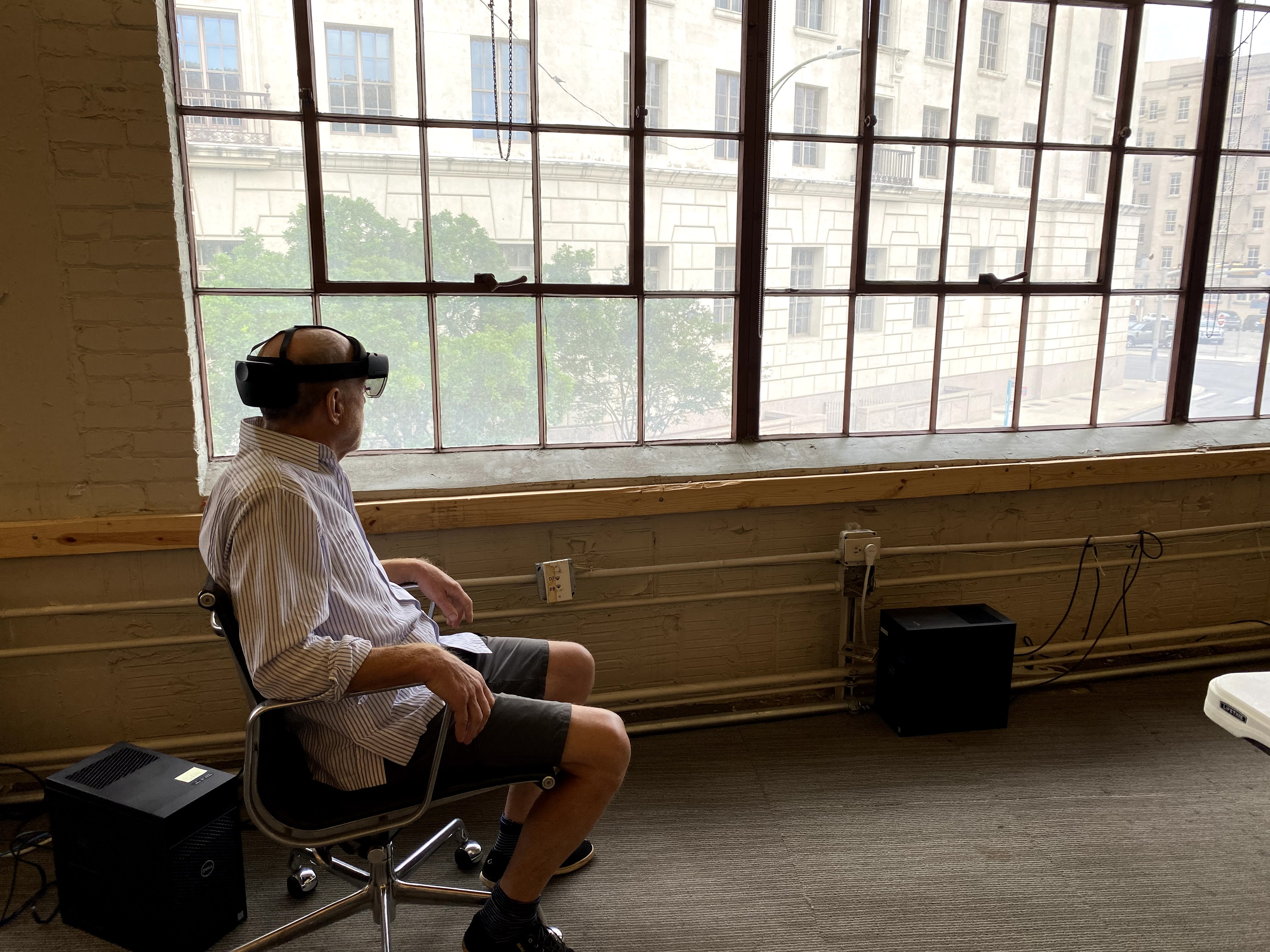 Ted Flato, seated, using Microsoft HoloLens 2