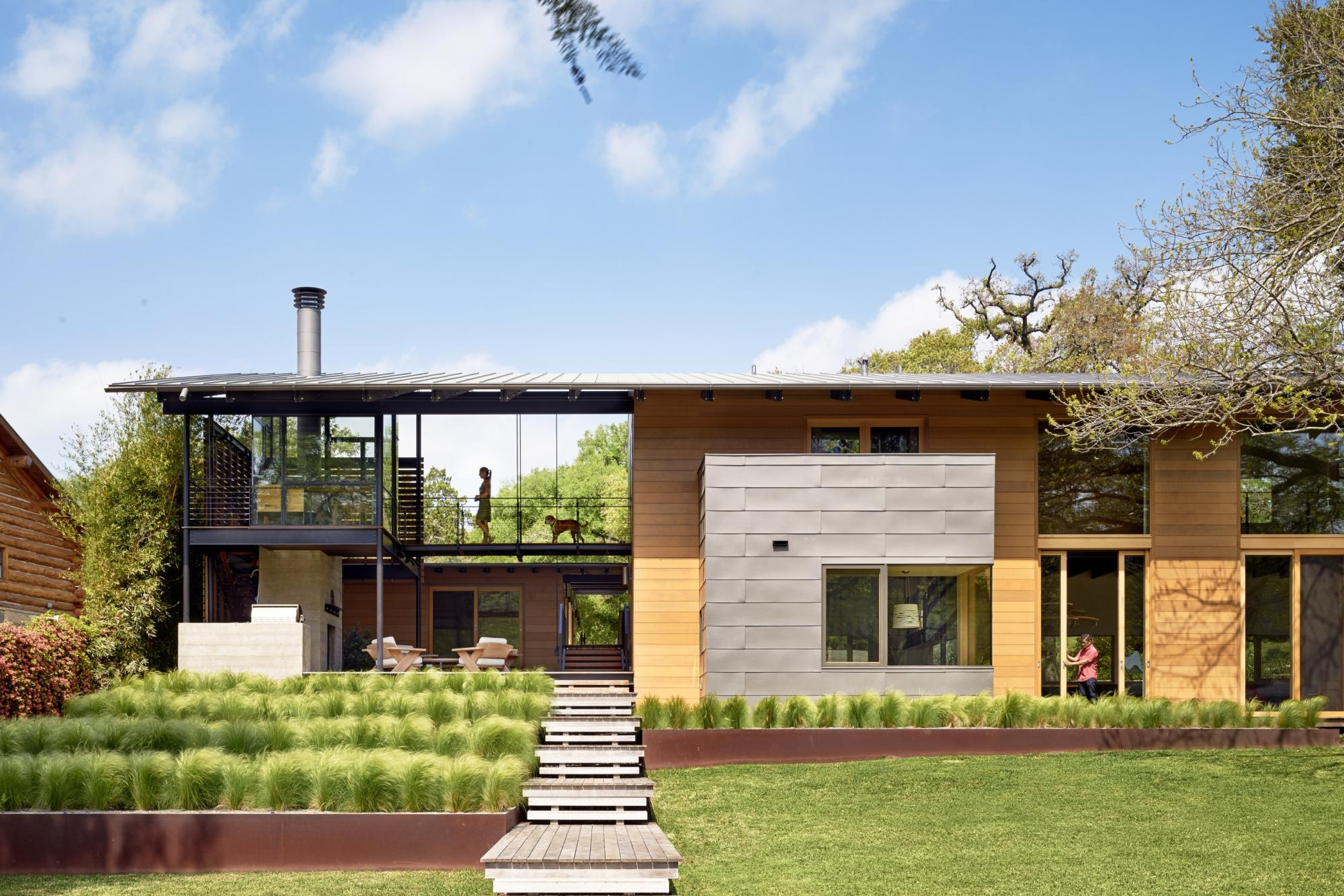 Situated at the confluence of Hog Pen Creek and Lake Austin, Hog Pen Creek Residence was envisioned by its owners as a place that evokes the playfulness of summer on the lake and emphasizes exterior living space. Towering heritage oak trees, a steeply slo