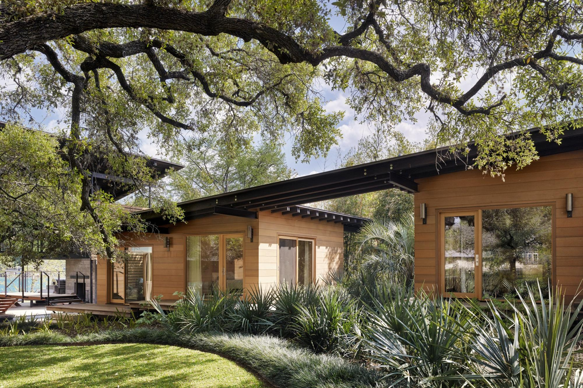 Towering heritage oak trees shade the front lawn and separate  guest quarters