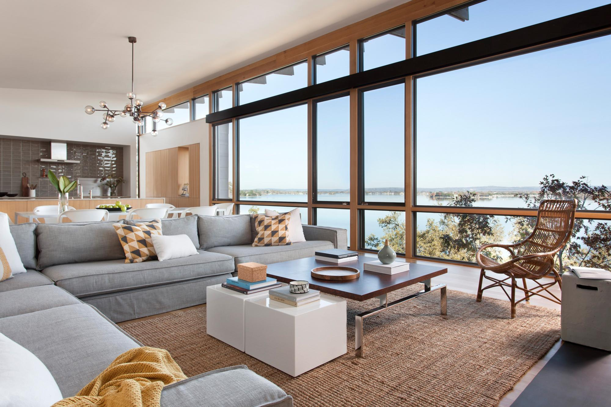 An award winning vertically structured lake house The long, narrow three-story residence dramatically culminates at the top floor, set just above the tree line and providing a nearly 180-degree view of the lake beyond