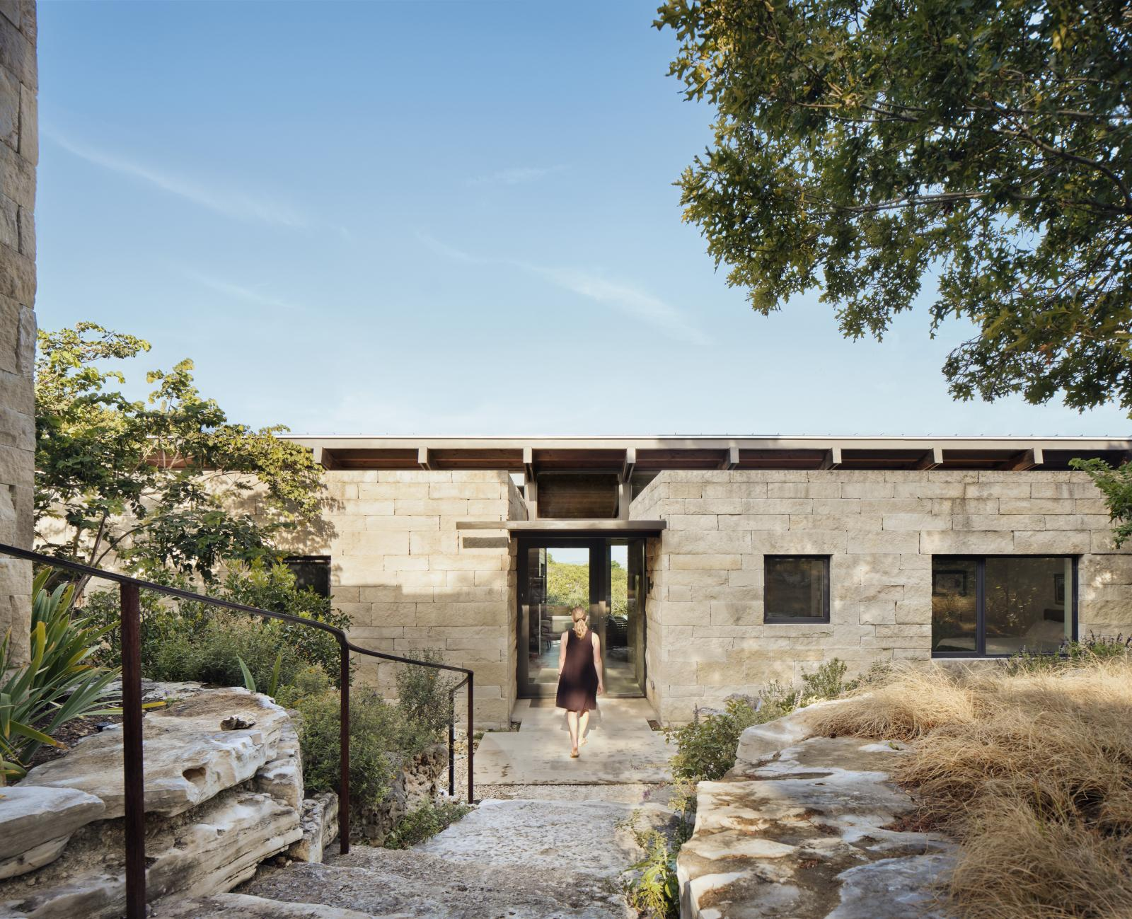 Canyon Preserve stair step down steep, rocky slopes of oaks and indigenous vegetation, creating a secluded and serene setting for this intimate house
