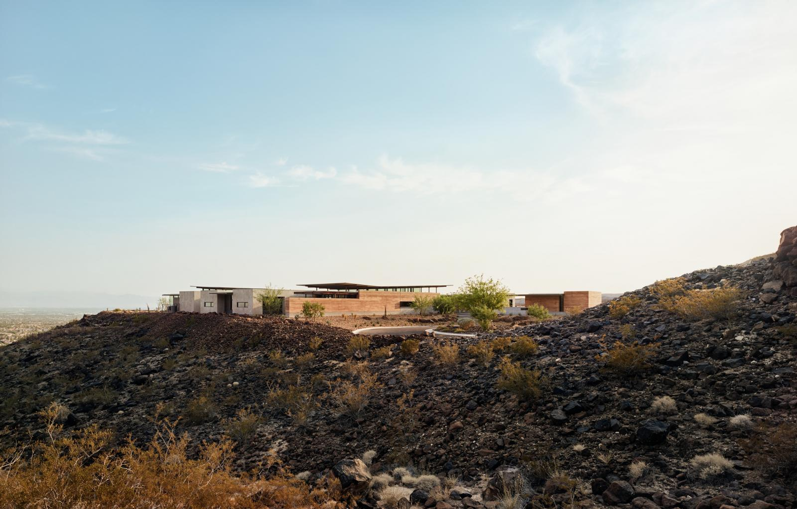 Horizon House uses rammed earth as the primary material which is designed to reflect the surrounding natural topography