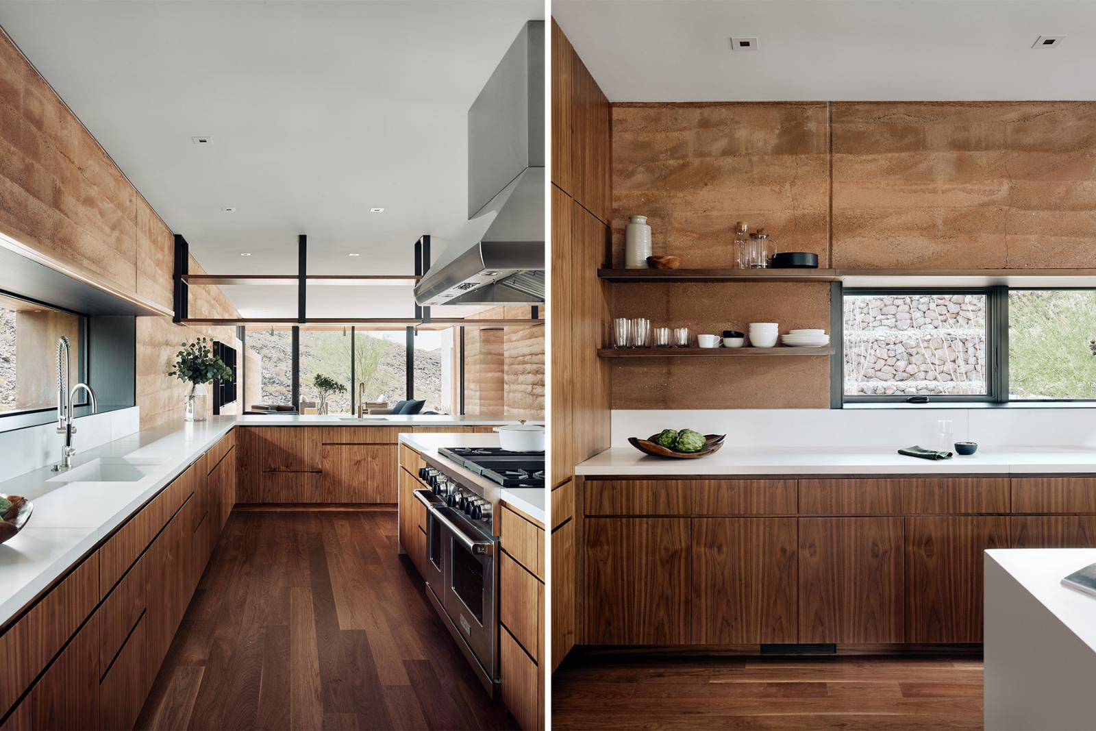 Interior kitchen views, boast of rammed earth walls, wood clad cabinetry and large windows with views to desert.