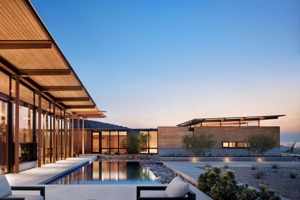 Horizon House uses rammed earth as the primary material which is designed to reflect the surrounding natural topography.